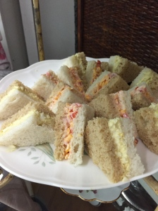 Tea sandwiches: egg salad and tomato with cheese